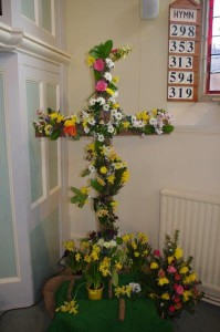 On Easter Morning the empty cross is decorated with flowers by the congregation during the singing of the first hymn